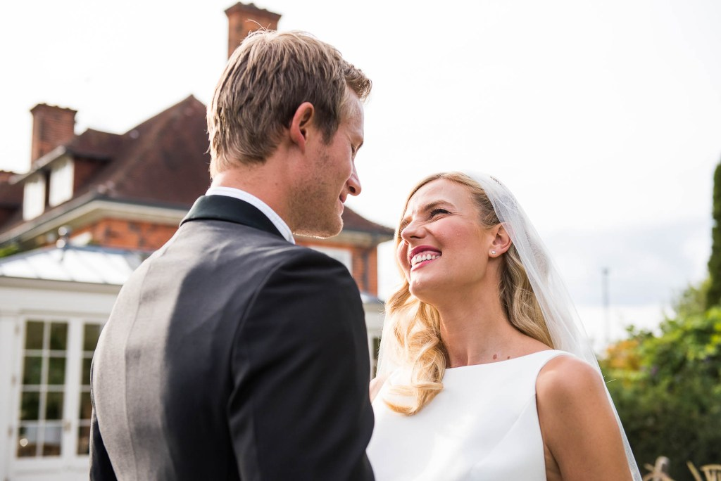Outdoor Wedding Photography Surrey, Bride and Groom Laugh With Each Other