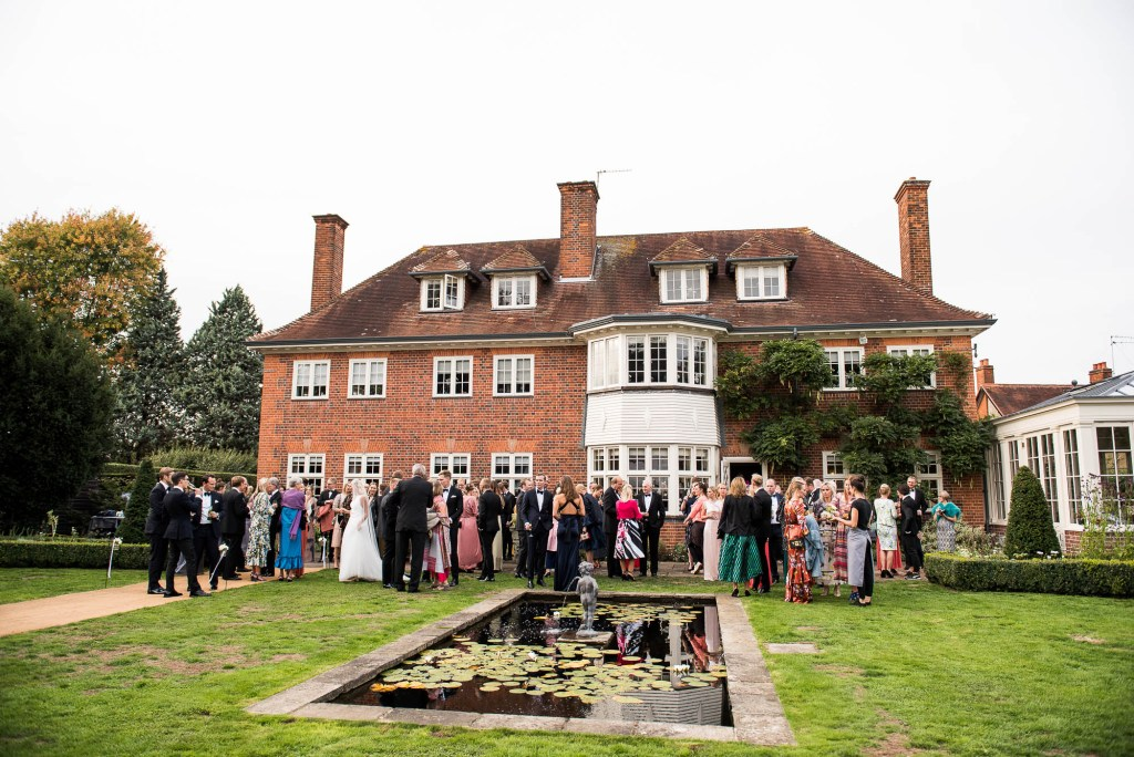 Outdoor Wedding Photography Surrey, Guests Gather For A Black Tie Wedding Reception At A Surrey House