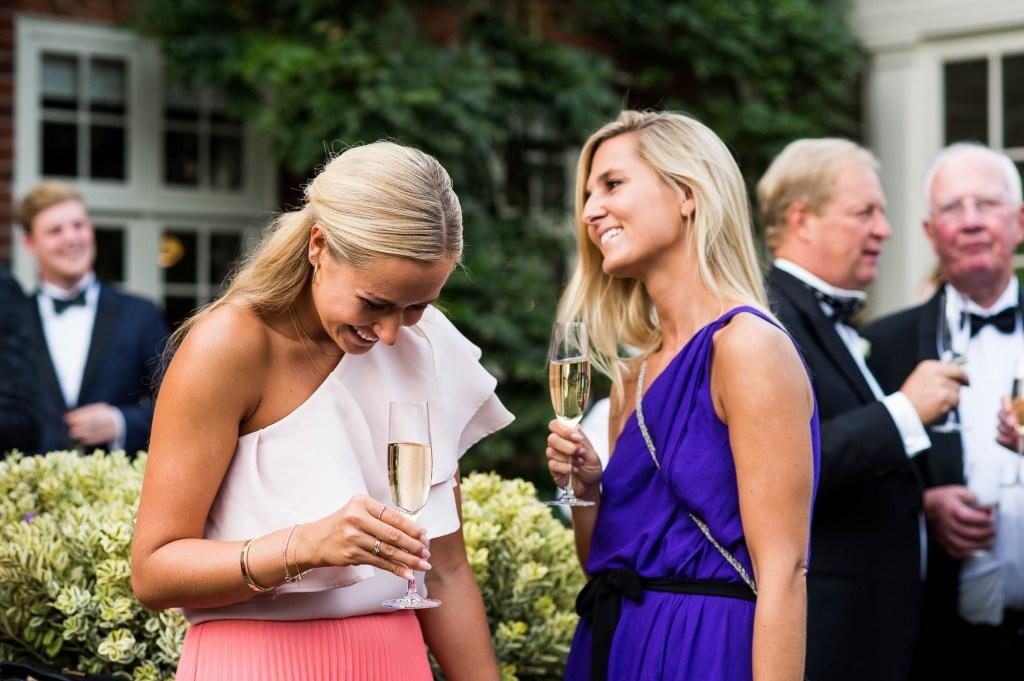 Outdoor Wedding Photography Surrey, Glamorous Wedding Guests Enjoy an Outdoor Black Tie Wedding Reception