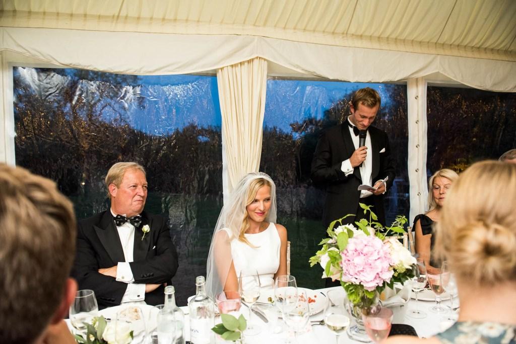 Outdoor Wedding Photography Surrey, Wedding Party Listen As Groom Gives A Speech
