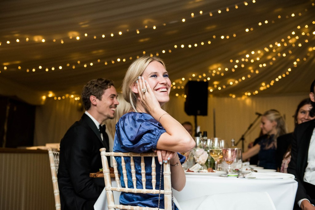 Outdoor Wedding Photography Surrey, Wedding Party Listen With Smiling Faces As Groom Speaks