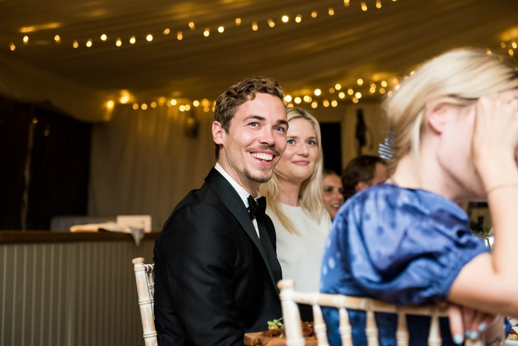 Outdoor Wedding Photography Surrey, Smiling Guests as They Listen To Speeches