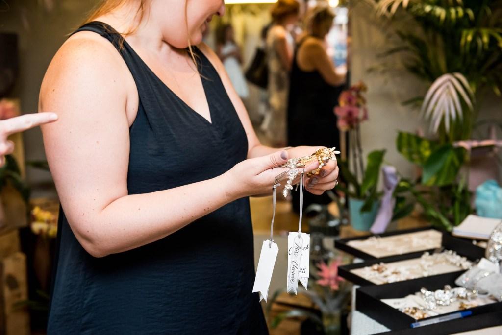 Miss Bush Bridal, British designer Miss Clemmie applying Jewellery, Surrey Wedding Photography