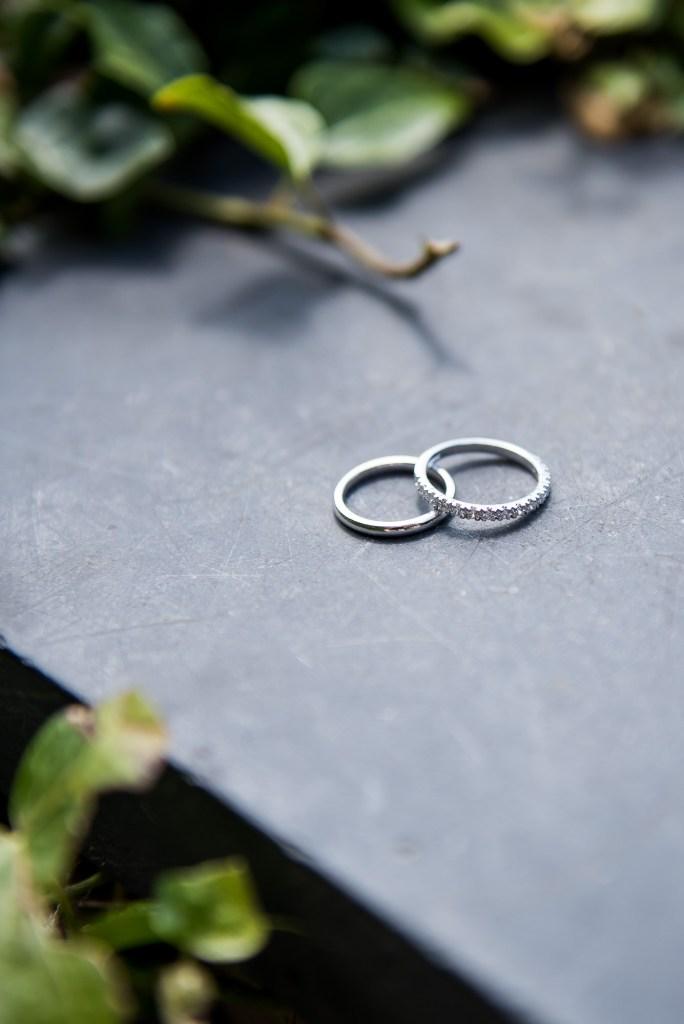 lgbt wedding photographer, Wedding rings arranged together