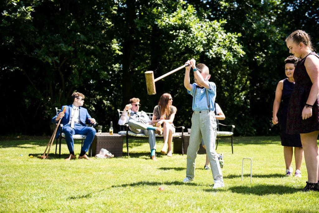 lgbt wedding photographer, guests mingle in the garden of Dodmoor House wedding venue