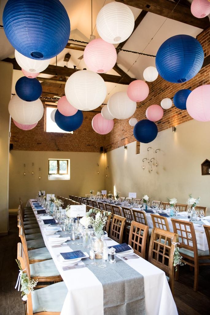 lgbt wedding photographer, wedding reception room decorated with assorted pastel paper lanterns