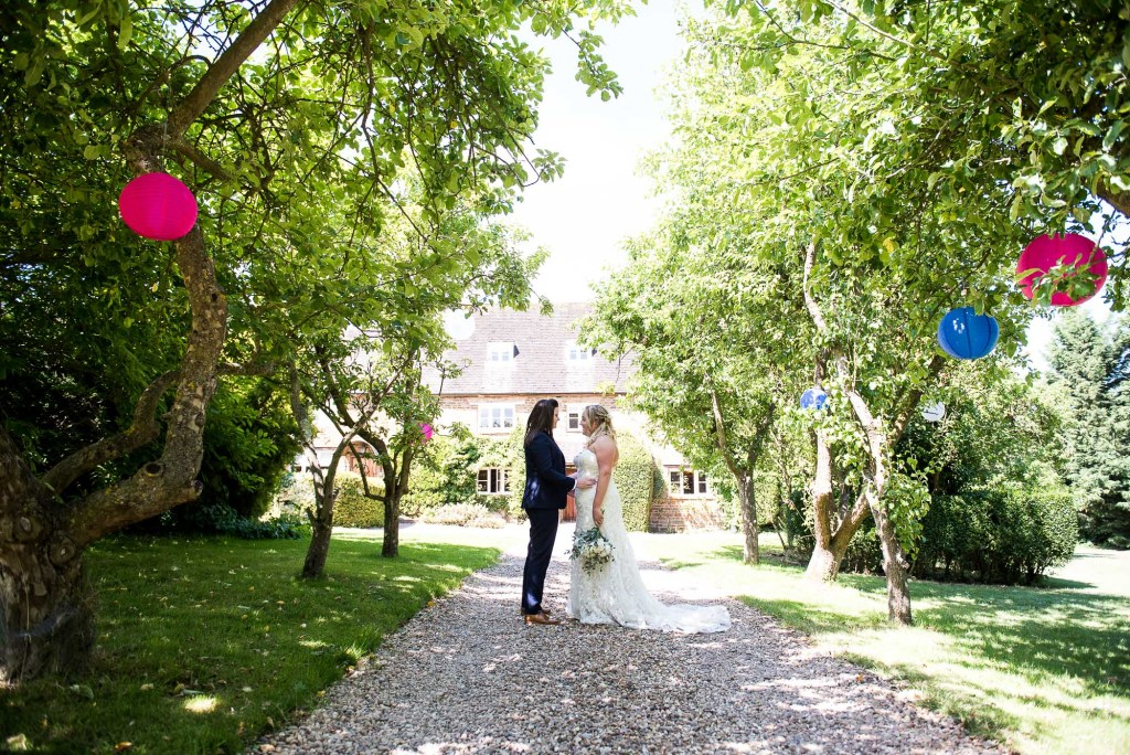 lgbt wedding photographer, gorgeous brides stand in the share of birch trees at Dodmoor House Wedding Venue