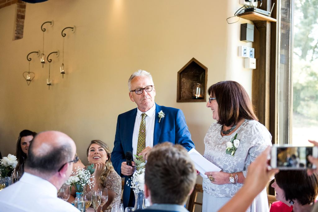 lgbt wedding photographer, father and mother of the bride give a speech, Dodmoor House Wedding