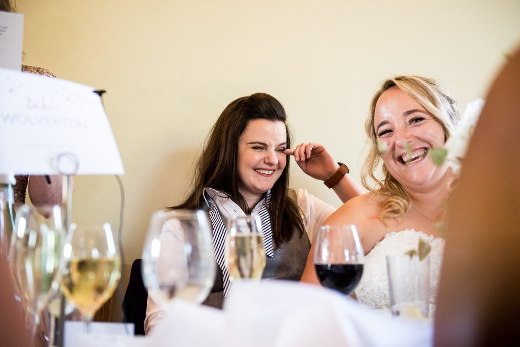 lgbt wedding photographer, brides share an intimate moment during speeches, Dodmoor House Wedding