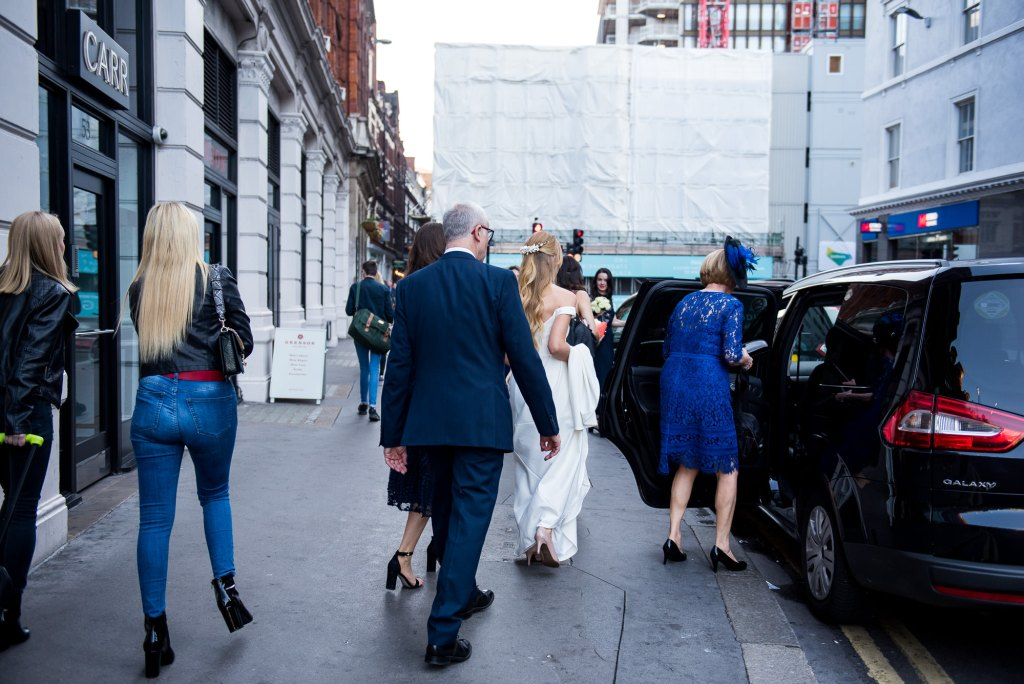 Old Marylebone Town Hall Wedding, bride makes her way to the cermeony