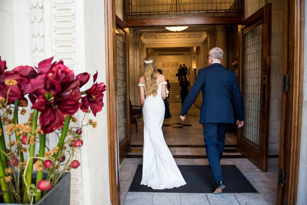 Old Marylebone Town Hall Wedding, father of the bride arrives with his daughter to London wedding