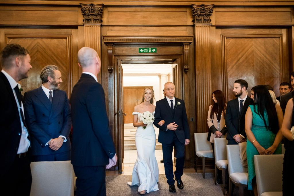 Old Marylebone Town Hall Wedding, groom's reaction as bride walks down the aisle