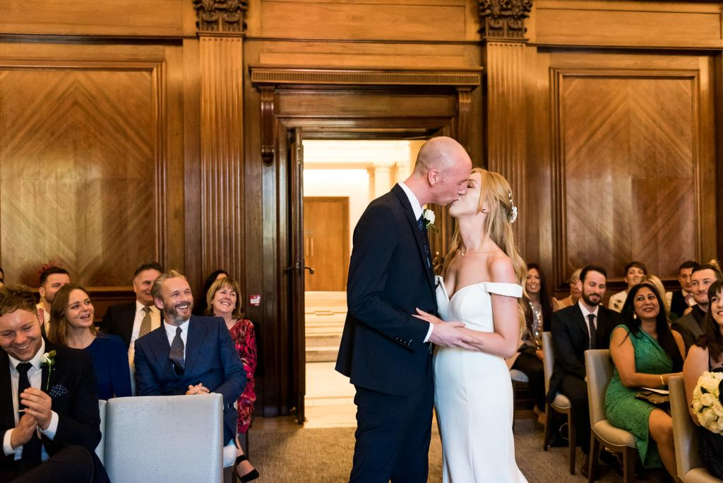 Old Marylebone Town Hall Wedding, Bride and groom share first kiss