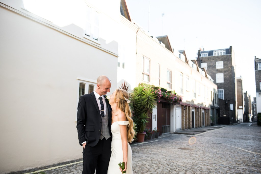 Old Marylebone Town Hall Wedding, candid couples portrait in traditional London mews