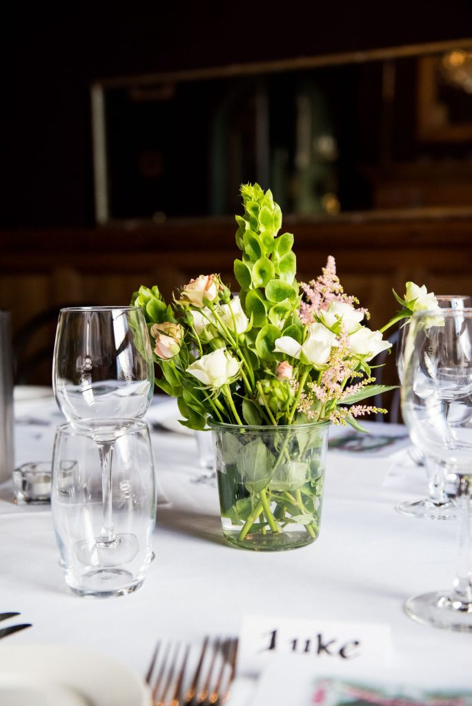 Old Marylebone Town Hall Wedding,  green and fresh wedding florals with soft pink tones and white roses
