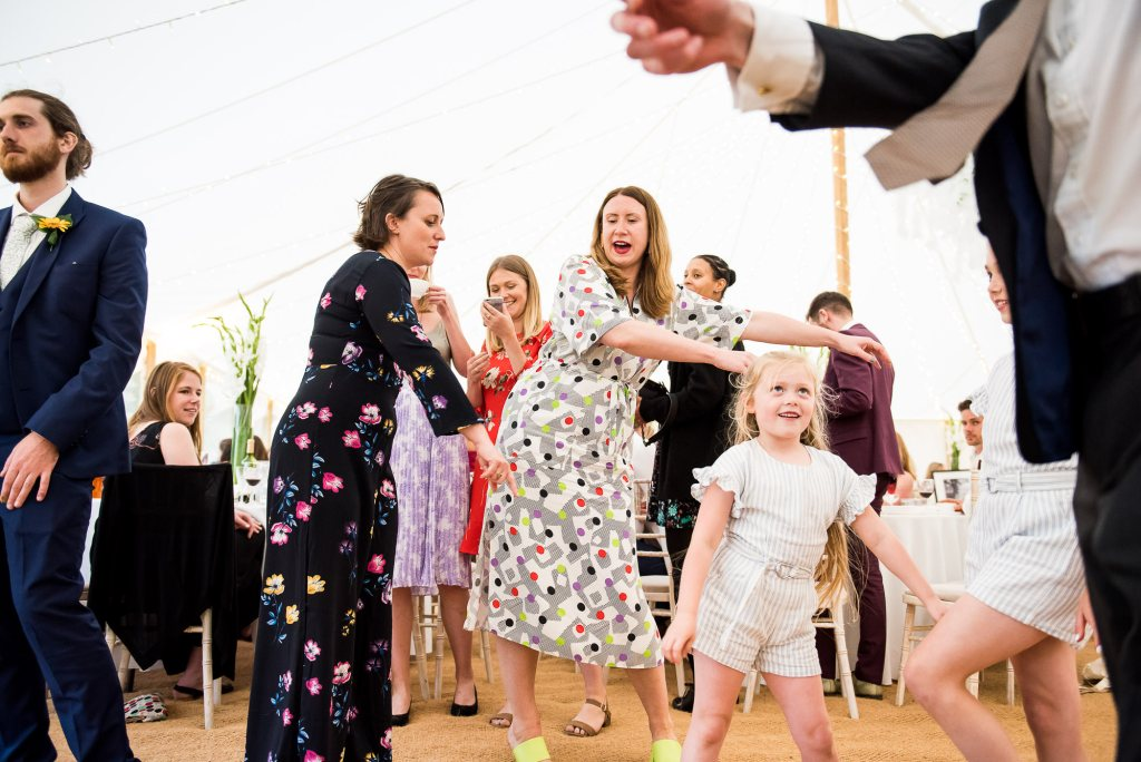LGBT wedding photography, wedding guests dancing the floss with children