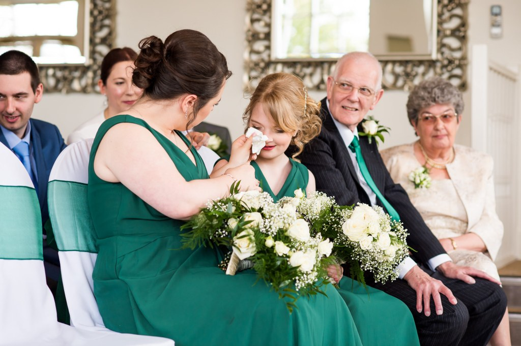 LGBT wedding photography, wedding guests shed a tear during the ceremony