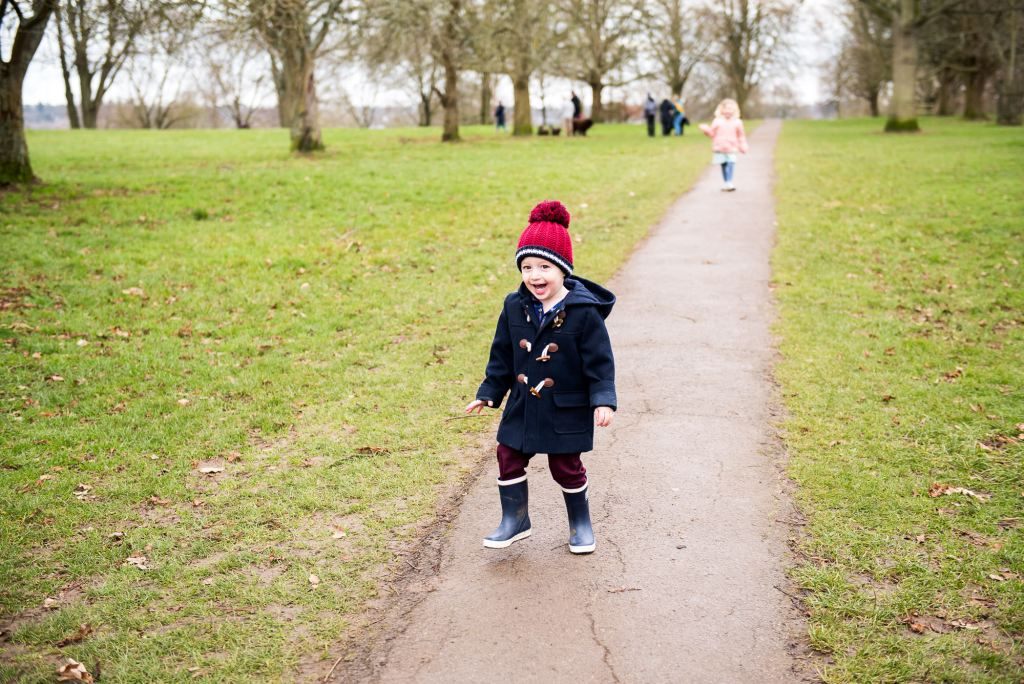 family photography guildford, little boy runs excitedly down a path