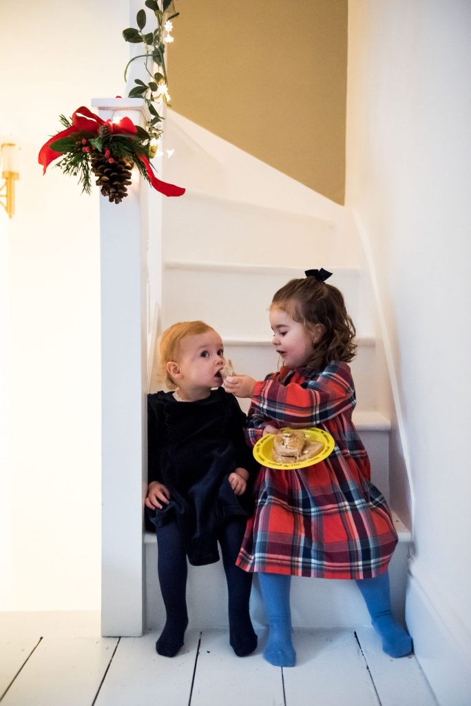 Cousins sit on the stairs together sharing food