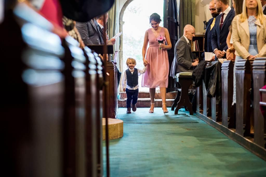 st martha's wedding, little groomsmen and bridesmaid walk down the aisle