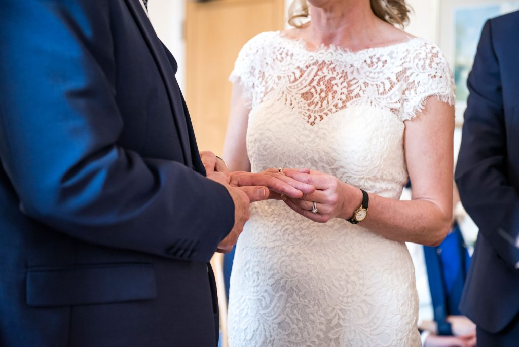 Ring exchange in registry office ceremony