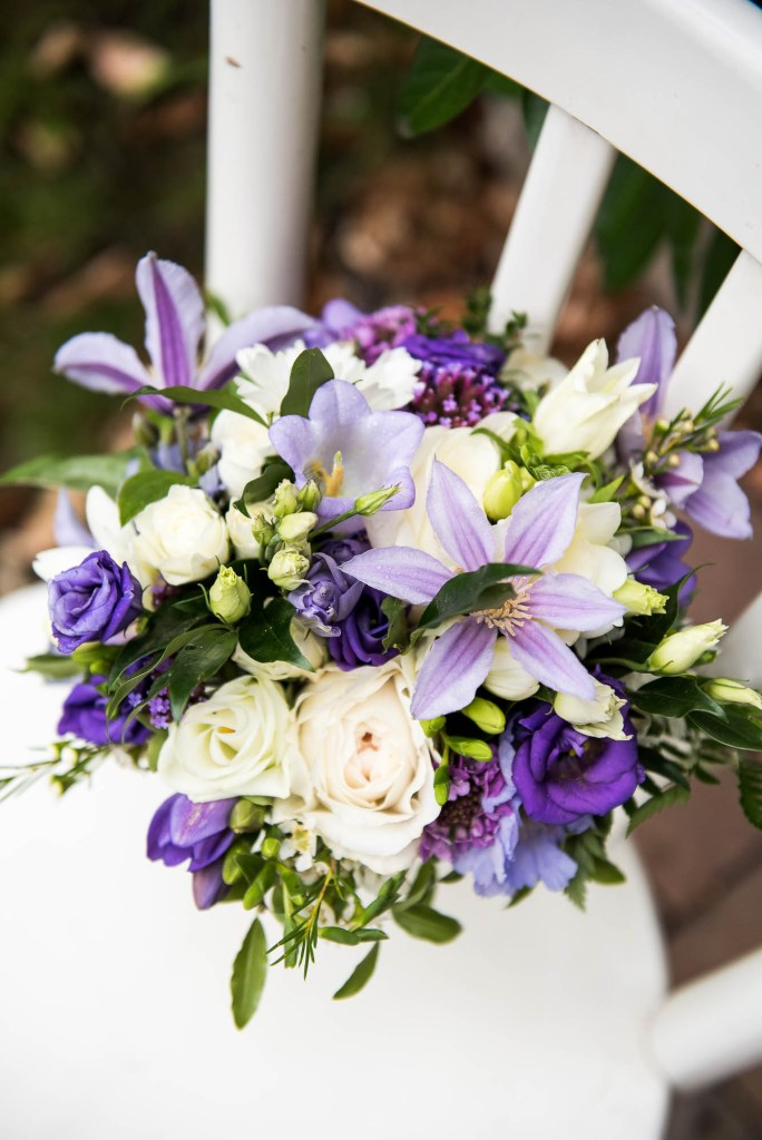 Wedding bouquet with green, white and purple floral arrangements