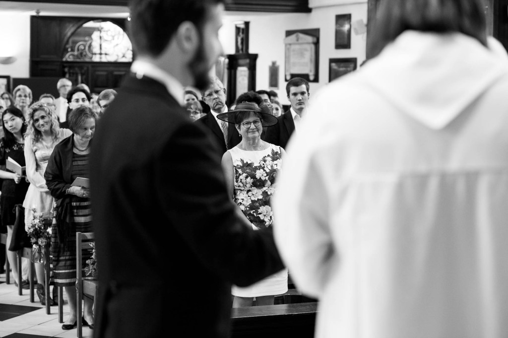 Black and white image of mother watching her daughter get married