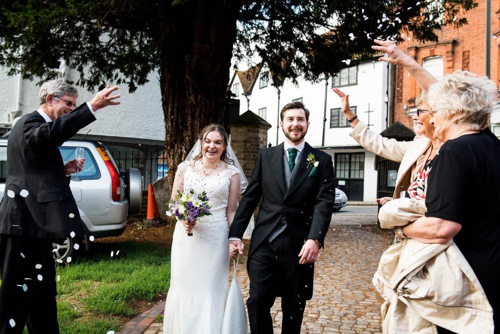 Confetti is thrown over the happy couple at St Mary's church in Guildford