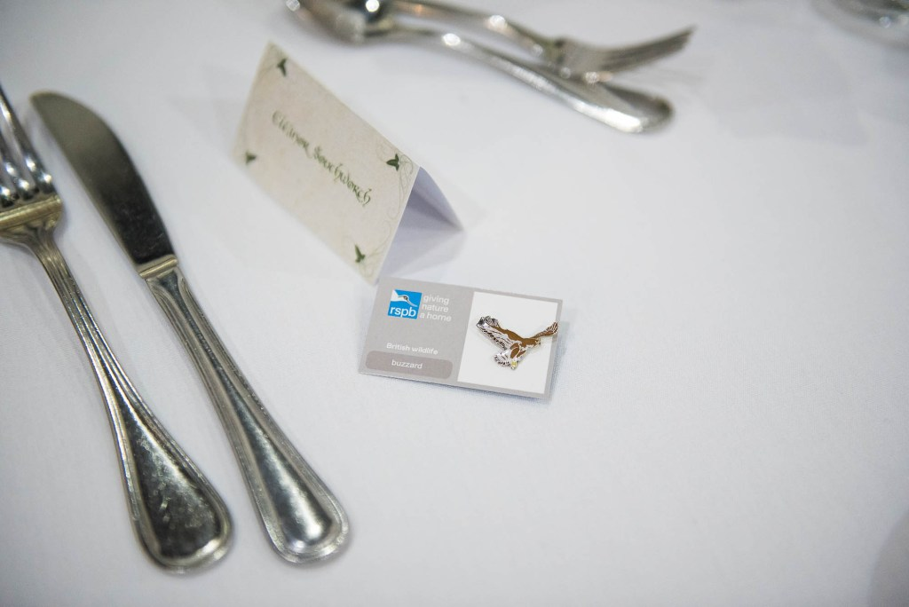 Wedding favours for guests consisting of badge pins of charities