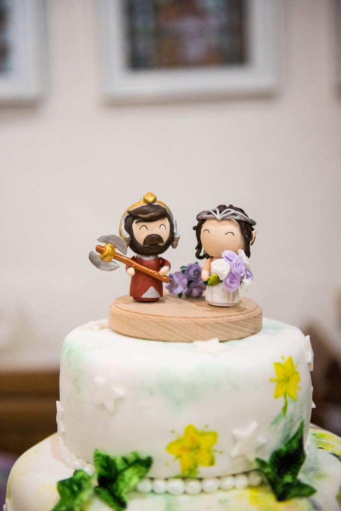 Elven figurines stand atop wedding bespoke wedding cake