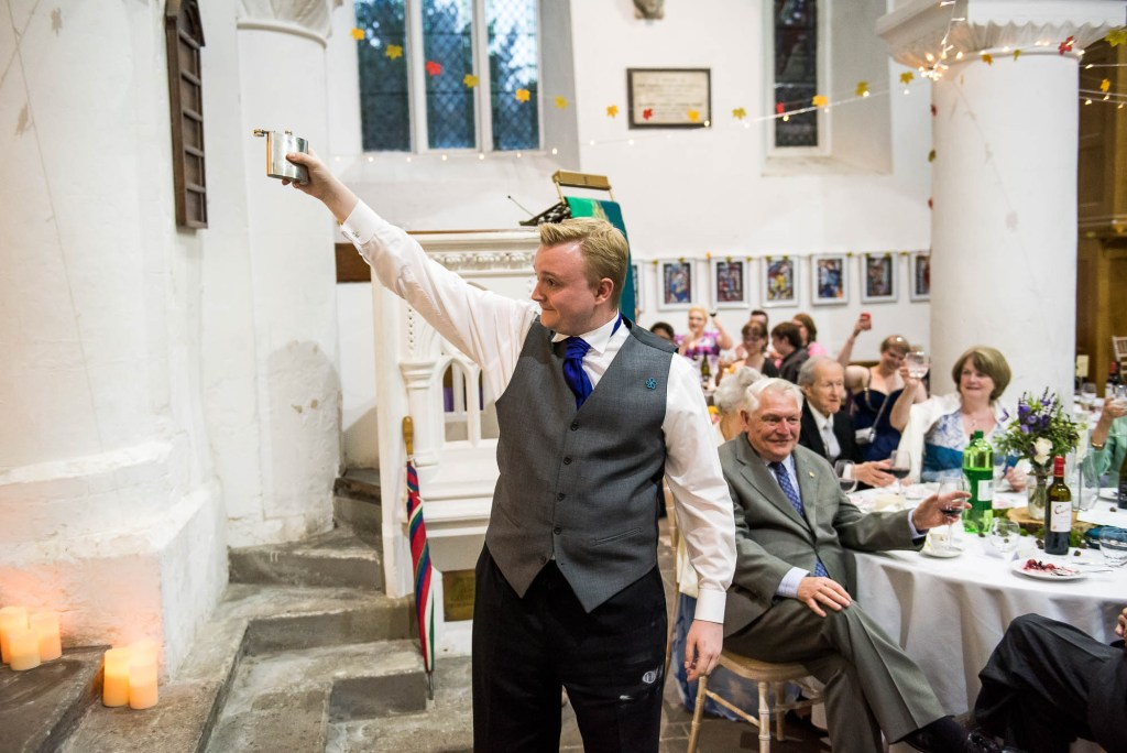 Best man raise a toast, Documentary wedding photographer surrey
