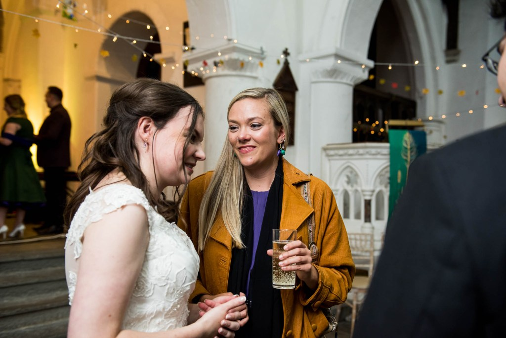 Documentary wedding photographer surrey, Guests chat candidly with the bride