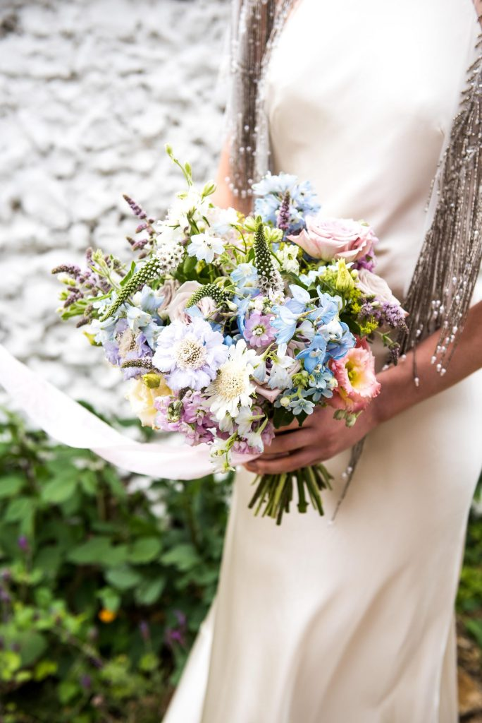 Pastel tone flowers of soft blue, pink and white summer flowers