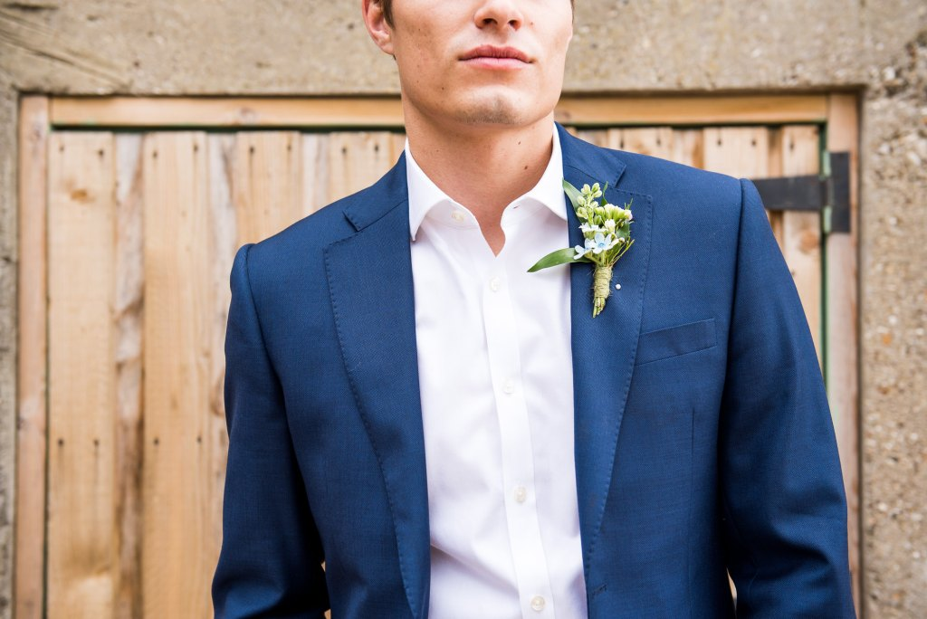 Navy blue suit with powder blue button hole