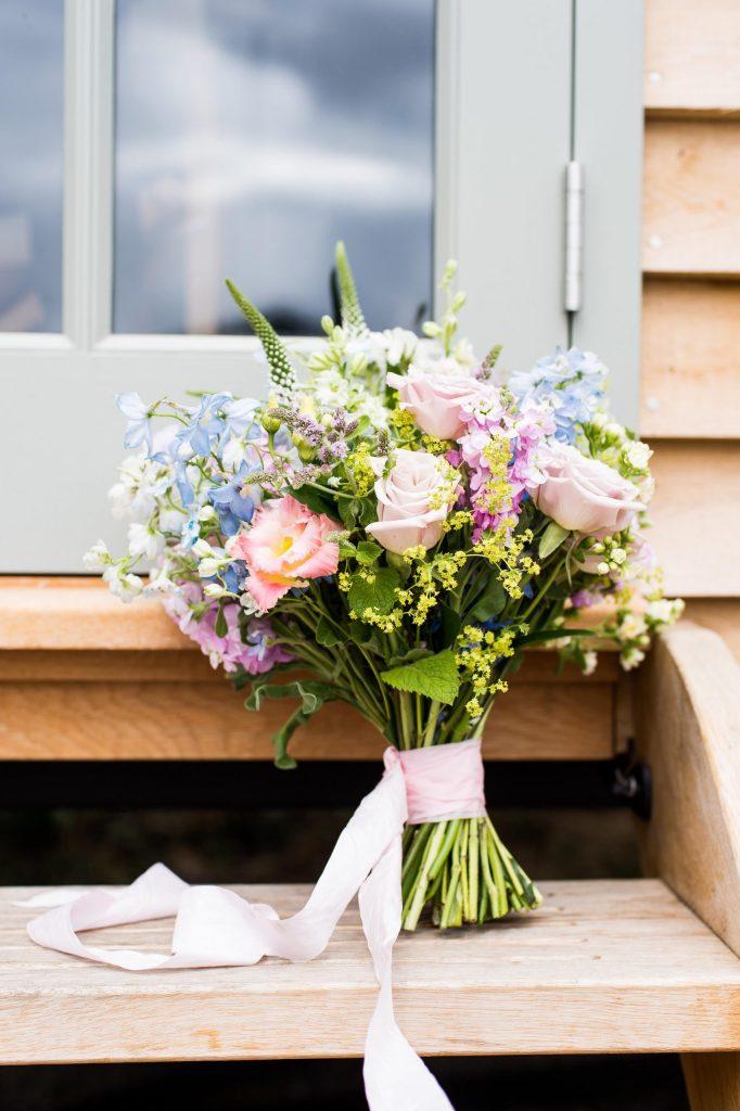 Pastel floral arrangement with pink silk ribbon for Surrey wedding shoot