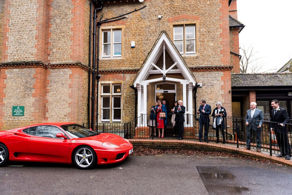 Bride arrives in a sports car for an Artington House wedding