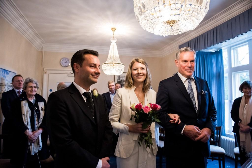 Natural wedding photographer surrey - bride enters registry office ceremony