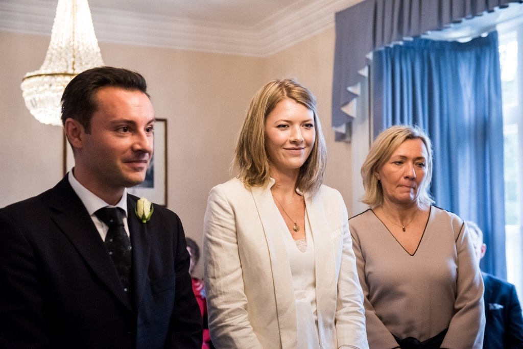 Smiling bride stands with her family at ceremony Artington House wedding