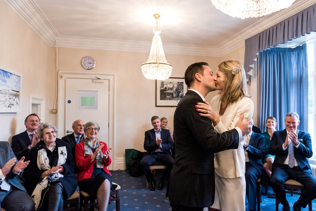 Artington House Wedding - bride and groom share first kiss