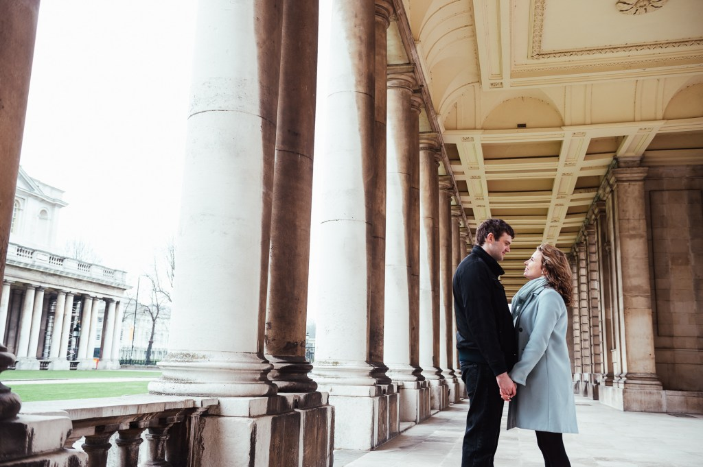 Couple stand looking at each other at Greenwich Naval College