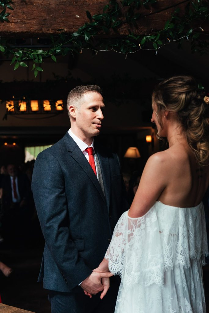 Handsome groom says his vows at the mill elstead