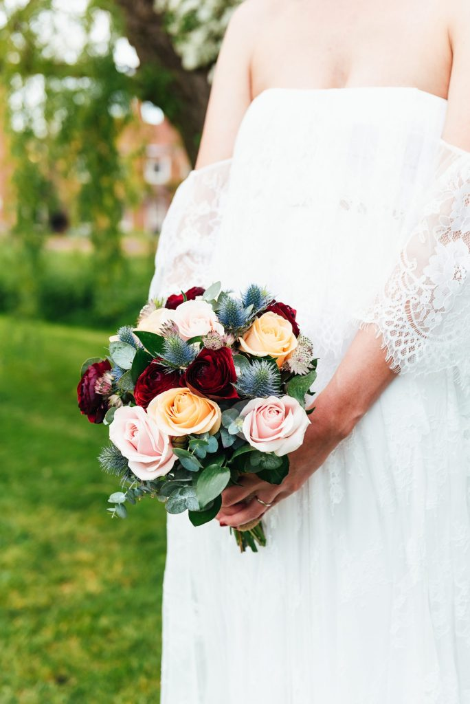 Beautiful green florals with red roses and white floral arrangement