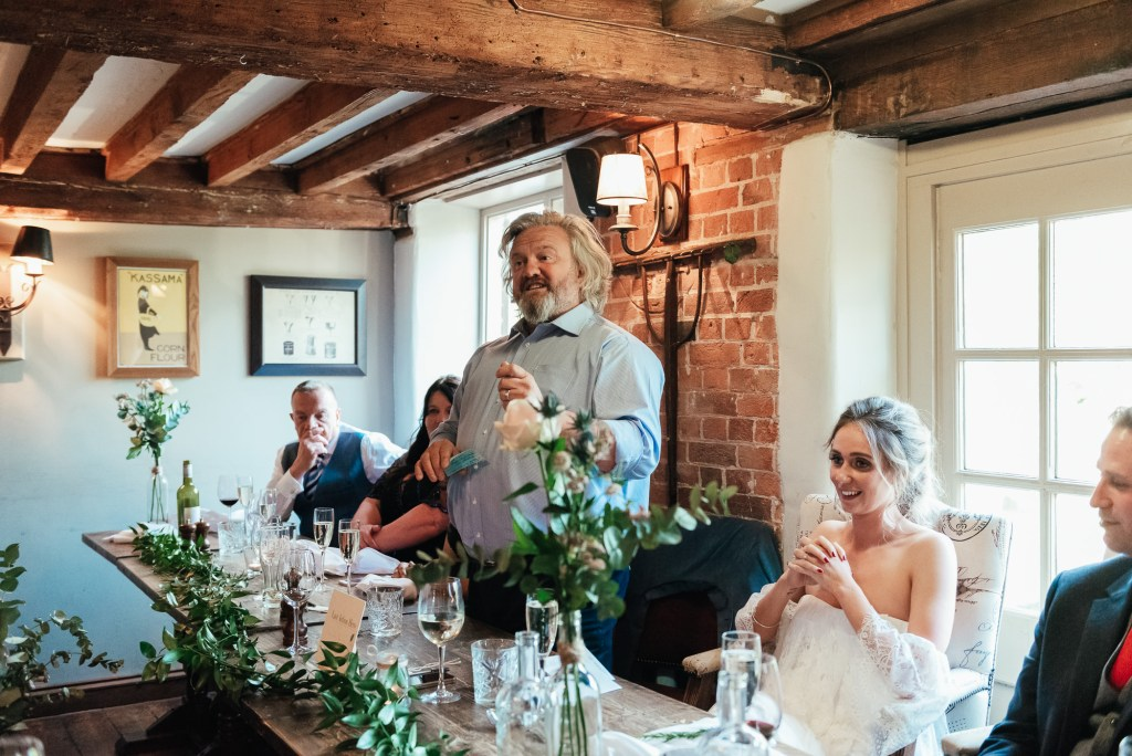 Father of the bride holds a speech at the wedding breakfast