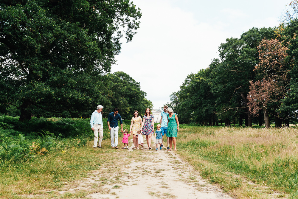 Family walk together in Richmond Park