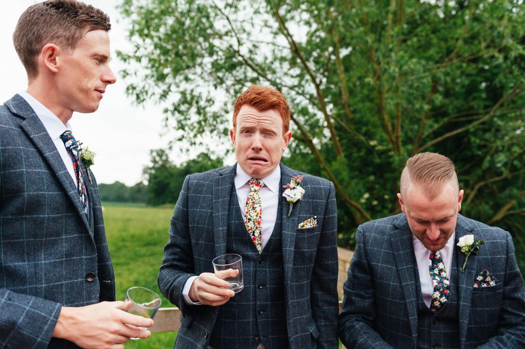 Groom pulls a face after whiskey shot