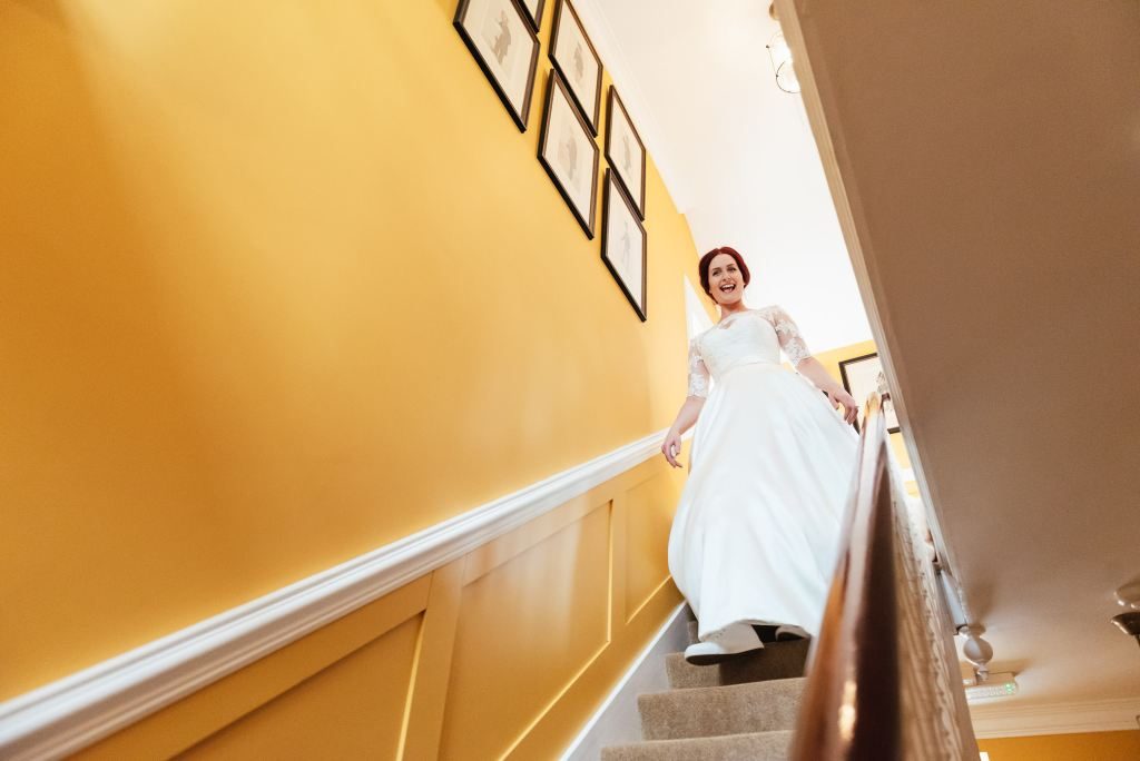 Bride makes her entrance in her dress for the first time
