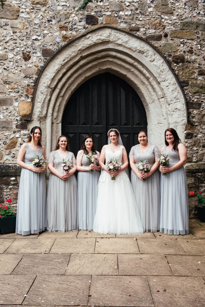 Bridesmaid wedding portrait with pale grey dresses and pastel wedding bouquets