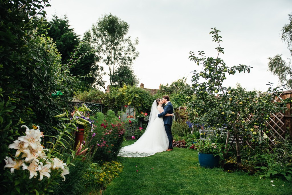 Beautiful English garden for bride and groom wedding portraits