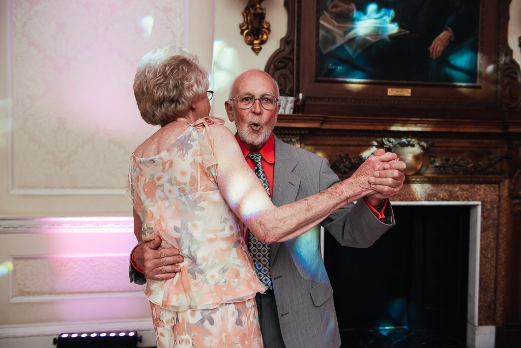 elderly couple dance together