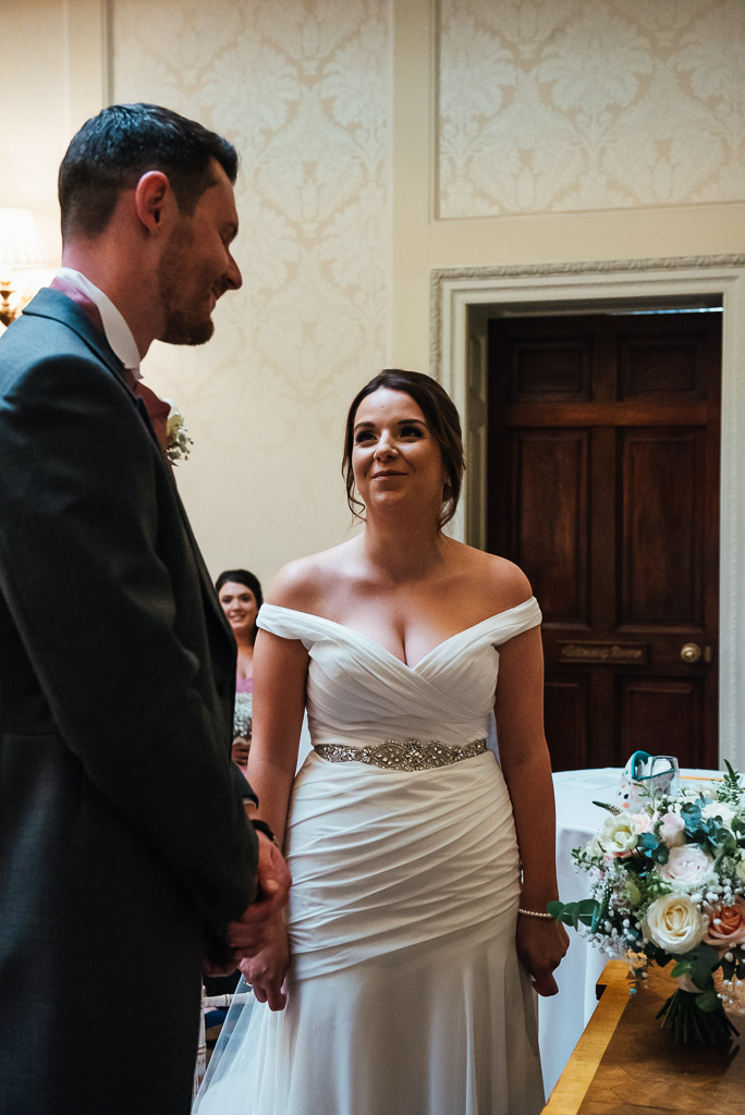 Beautiful bride looks at her husband to be